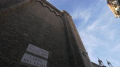 Basilica dei Frari with tall brick walls and round windows in Venice Stock Footage