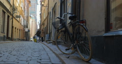 Man and woman with travel bag wandering in old city street Stock Footage