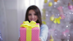 Young smiling model holding big box Stock Footage