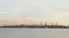 Calm Riverscape With Industrial Factory Against Grey Sky Stock Footage