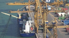 4K Aerial view cargo ship load container international goods crane machine work  Stock Footage
