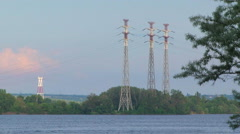 High Voltage Power Transmission Electric Poles Near River Stock Footage