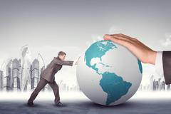 Businessman pushing earth globe - stock photo