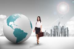 Buisnesswoman with big earth globe - stock photo