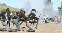 Blue and Grey Civil War Reenactment Soldiers Firing at Each Other Stock Footage