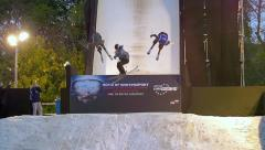 Display by ski and snowboard champions - stock footage