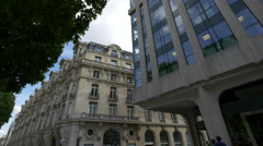 Hugo Boss store and HSBC Bank on Avenue des Champs-Elysees, Paris Stock Footage