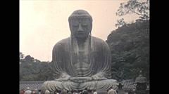 Vintage 16mm film, 1970, Japan, Bhudda statue people b-roll - stock footage