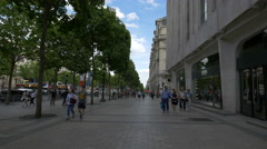 Walking by Hugo Boss store on Avenue des Champs-Elysees, Paris Stock Footage