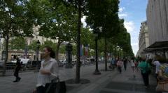Passing by Nespresso Boutique on Avenue des Champs-Elysees, Paris Stock Footage