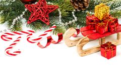 Bright christmas composition with sledge Stock Photos