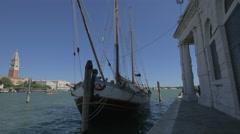 Sailing boat anchored near Punta della Dogana di Mare in Venice Stock Footage