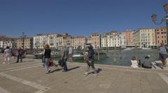 Tourists walking on Fondamenta Salute in Venice Stock Footage