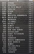 Depature schedule board in airport - stock photo