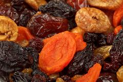 Various dried fruits (apricots, dates, raisins, figs) close-up - stock photo