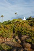 Small Buddhist dagoba on sunset. Unawatuna, Sri Lanka Stock Photos