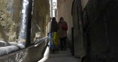 Two tourists walking in old narrow street, Stockholm Stock Footage
