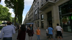 Walking on Champs-Elysees, next to Longchamp leather goods store, Paris Stock Footage