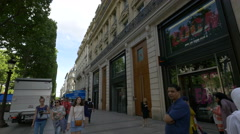 Nike and Tommy Hilfiger stores on Avenue des Champs-Elysees, Paris Stock Footage