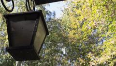 Old lantern on the arbor autumn park Stock Footage