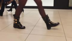 Feet of people walking around the room Arkistovideo