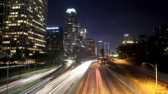 Time lapse of night traffic car lights on the freeway in Los Angeles California Stock Footage