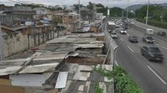 Slum near highway in Rio de Janeiro Stock Footage