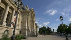 Walking and sitting on stairs next to Petit Palais entrance, Paris Stock Footage