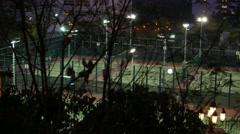 Tennis courts area at private residential area, surrounded with park Stock Footage