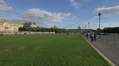 Walking in Esplanade des Invalides, near the Les Invalides in Paris Stock Footage