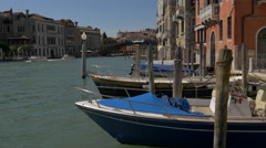 Boats floating close to the Academy Bridge in Venice Stock Footage