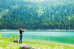 Traveler at the lake - stock photo