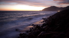 Time lapse of sunset clouds and Pacific Ocean waves at Point Mugu California Stock Footage