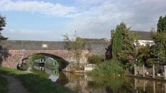 Canal Bridge narrowboat public house blue sky rural scene Stock Footage