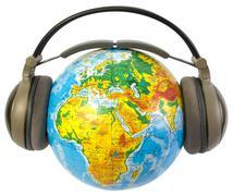 Earphones on world globe isolated Stock Illustration
