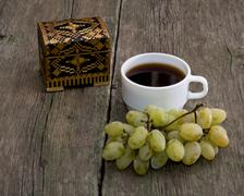 Casket, coffee and cluster of grapes Stock Photos
