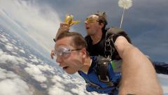 Skydiving tandem hilarous with a banana - stock footage