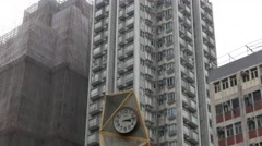 Pan shot of modern small clock structure in Sei Yee Street Garden Stock Footage