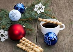The fir-tree branch decorated with spheres and a snowflake coffee and baking Stock Photos