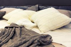 White pillows on hotel bed Stock Photos