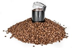 Coffee mill and pile of coffee beans - Isolated - stock photo