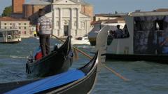 Gondolas and boats near Church of San Giorgio Maggiore in Venice Stock Footage