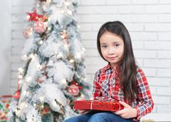 The little girl in anticipation of the new year - stock photo