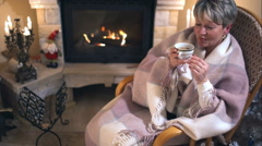 Mature woman relaxing in the cozy living room - stock footage