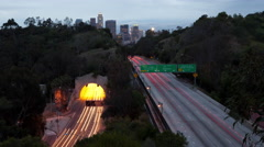 Time lapse of traffic on the 110 freeway and Los Angeles skyline in the evening Stock Footage