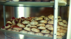 Shot of typical italian sweets and desserts in a showcase Stock Footage