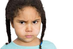 Angry Girl Staring at You Against White Background Stock Photos