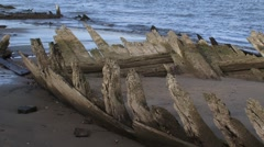 Ancient remains of a wooden vessel on the riverbeach of the Rhine Stock Footage
