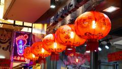 Chinese ball paper lamp decoration hang in line under under signboard Stock Footage