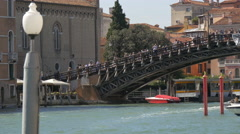 Many people walking on the Academy Bridge in Venice Stock Footage